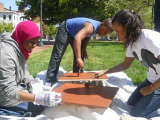 "Information about the Images: Design Apprenticeship Program students work as a team to design and build mobile education ""carts"" for the National Museum of Natural History's new Education Center. The students worked closely with National Museum of Natural History staff to understand how the mobile education ""carts"" would be used, to better inform their design and prototype, seen here being built. All images courtesy of the National Building Museum."