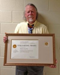 Bruce Collettee with Gold Medal Award certificate. Photo by Ruth Gibbons.
