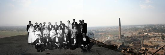 In the Belgian Congo, Europeans were expected to dress formally for all official occasions, especially if they were to be seen by local inhabitants. Their attire was a sign of belonging to the elite, but was also justified as a means of leading by example. The placement of individuals atop a slag heap in this image evokes the grand life the Europeans were able to enjoy as a result of the mining economy below. Sammy Baloji.