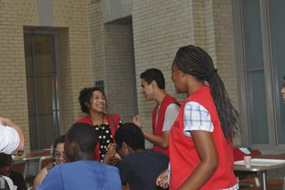 YAB members Olivia Persons, Mario Orellana, and Jasmine Jackson laugh as they encourage some healthy competition among teen participants in the first ever NMNH EvoTrek Teen Scavenger Hunt. Image courtesy of the Smithsonian Institution.