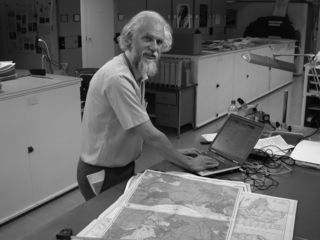 Jim Harle creates a database of maps. (Photo by Deborah Bell)