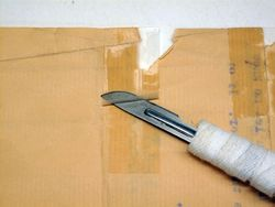 Tape removal using a heated scalpel