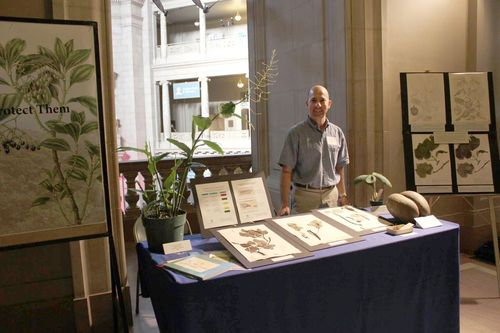 Gary Krupnick displays living and dried specimens of endangered and extinct species at Congressional Night at the Smithsonian. (Photo by Elaine Haug)