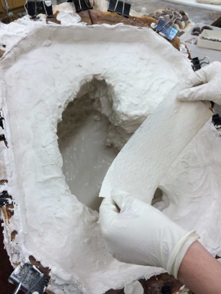 Building the cast with plaster and fiberglass