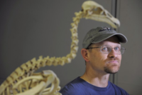 Brian Schmidt with condor skeleton - Matt McClain/Wash. Post