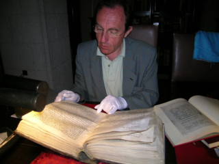 Alain Touwaide deciphering a manuscript conserved in the library of the Monastery of St. John, Patmos Island, Greece, 2007 (Photo by Emanuela Appetiti)