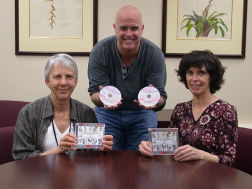 Ellen Farr (left), Rusty Russell, and Alice Tangerini display the new DVD set of plant type specimens. (Photo by Deborah Bell)