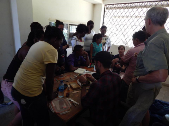 Anna talks with undergraduates from the University of Guyana about bird parasites.
