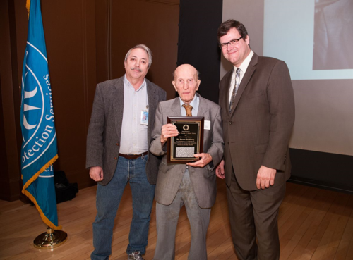 Botany Chair Warren Wagner and Kirk Johnson, Sant Director of the National Museum of Natural History, present Aaron Goldberg with the 2013 Career Contributions to Science Award. (photo by the Smithsonian Institution)