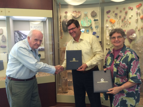 National Museum of Natural History Director Kirk Johnson (center) thanks Harold Robinson and Vicki Funk for a gift establishing an endowment toward research awards to people studying the Compositae collection. (photo by the Smithsonian Institution)