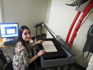 Ana Tkabladze creates digital images of historic field books. (Photo by Rusty Russell)