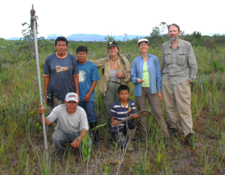 The expedition team in upland savanna. Back (left to right) Delph Hunter, Hondel Hunter, Karen Redden, Sara Alexander, Kenneth Wurdack; front, Claudius Perry with pruning poles, Carlos Jacobis. Virgil Roland not pictured. (Photo by local guide).
