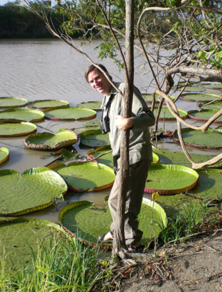Cristian Samper showing his botanical roots in Guyana. (Photo by Vicki Funk)
