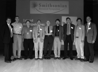 Speakers of the 2006 Smithsonian Botanical Symposium (from left): W. John Kress, Robert Ricklefs, Robert Fleischer, Warren Wagner, Sherwin Carlquist, Bruce Baldwin, Mike Maunder, Javier Francisco-Ortega, Ole Hamann (Photo by Jim Harle)