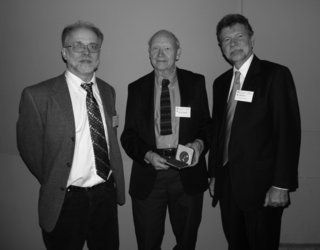 Sherwin Carlquist (center), recipient of the Jose Cuatrecasas Medal for Excellence in Tropical Botany, receives his award from Laurence Dorr (left) and W. John Kress.  (Photo by Jim Harle).