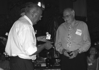 Dan H. Nicolson (right) receives the Stafleu Medal from Pieter Baas during the 17th International Botanical Congress in Vienna, Austria.  Photo by Alice C. Nicolson.