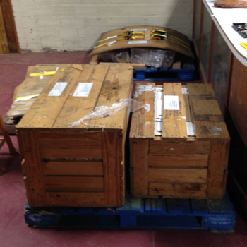 Pallets and wooden crates full of fossils