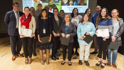 "Carolina Puente, Vicki Funk, and Ida Lopez (fourth, seventh, and eighth from left, respectively) receive the ""Scientific Team Engaging Young Minds (STEM) Award"" from NMNH Sant Director Kirk Johnson (left). (photo by the Smithsonian Institution)"