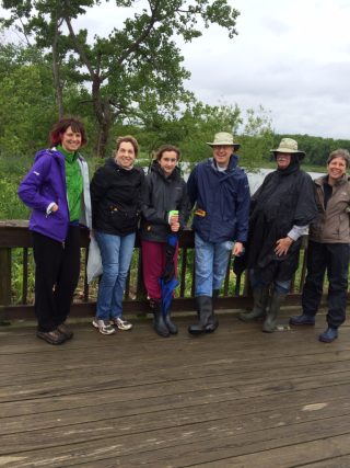 Nancy Khan (right) and fellow observers take a break during a BioBlitz of Dyke Marsh Wildlife Preserve. (photo by Suzanne Dingwell)