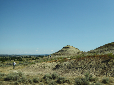 Approaching the outcrop, a small conical hill.