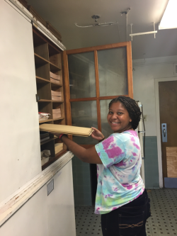 Howard University undergraduate student Morinne Osborne at work in the Howard University Herbarium