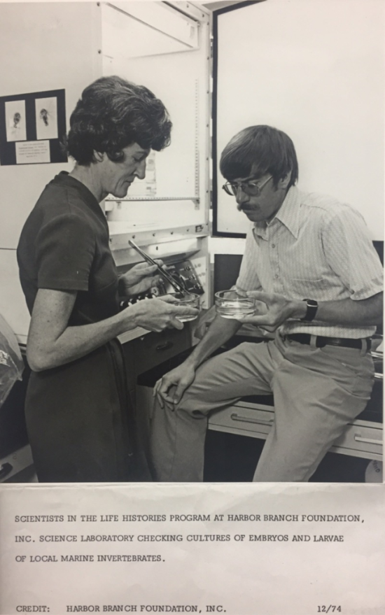 Mary Rice and Kevin Eckelbarger comparing specimens in the Life Histories lab in 1974, which was located on a barge on the campus of Harbor Branch Oceanographic Institute at the time.