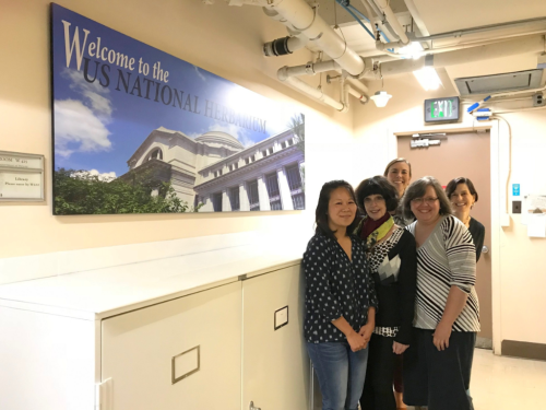 A new welcome sign greets visitors to the U.S. National Herbarium. Standing in front of the sign is the exhibit committee (from left): Ingrid Lin, Alice Tangerini, Melinda Peters, Robin Everly, and Rose Gulledge. (photo by Gary Krupnick)