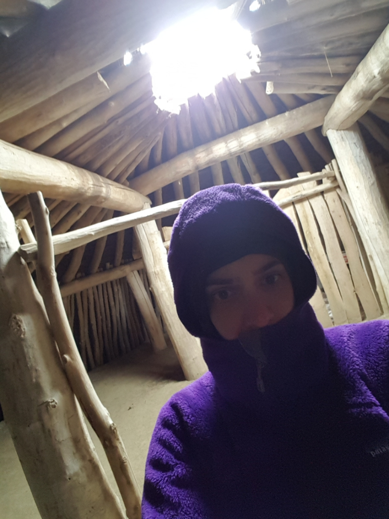 Selfie inside an earth lodge at On-A-Slant Village.