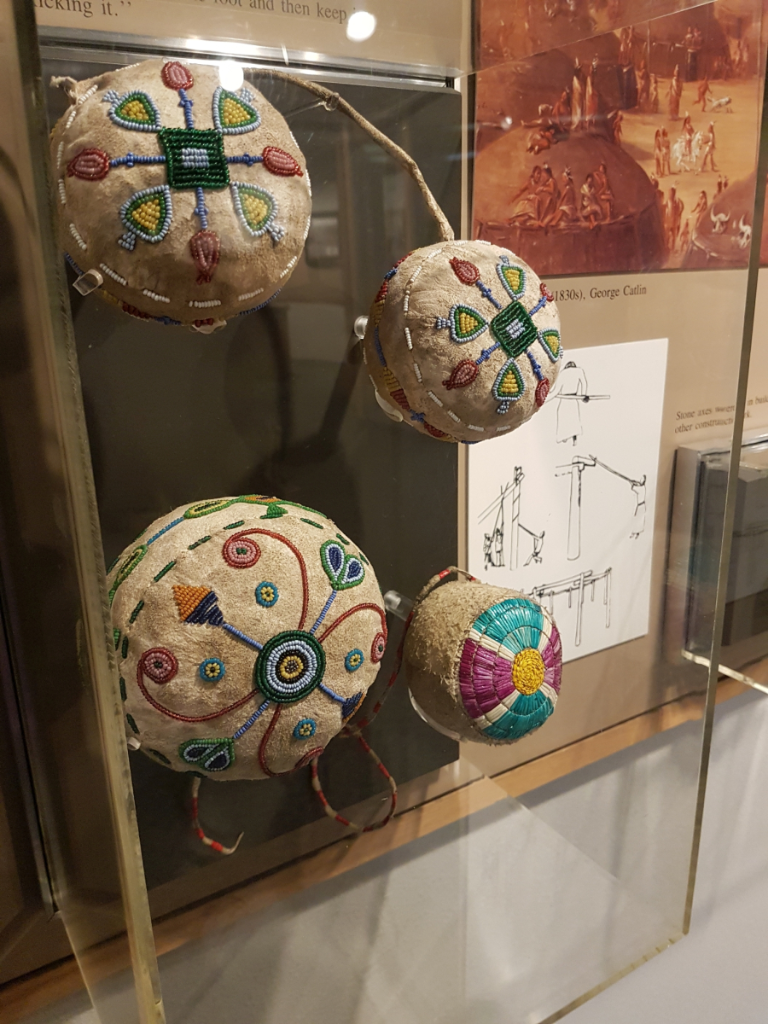 Another exhibit case showing quill- and bead work.