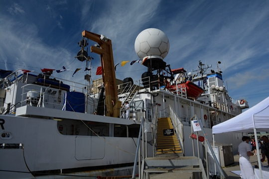Preparing to board the Okeanos. The white ball on top of the ship provides satellite communications at sea. The ship is operated by both commissioned officers and civilians.