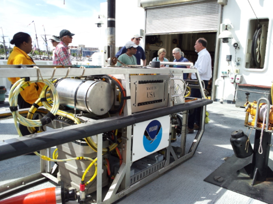 The NMNH volunteers learn about the Seirios camera sled that can be towed by the Okeanos.