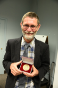 H. Peter Linder accepts the 2014 José Cuatrecasas Medal for Excellence in Tropical Botany. (photo by Ken Wurdack)