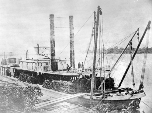 Late 19th century photo of the steamboat Far West docked along the Missouri river.