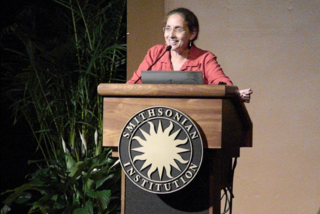 Speaker Ruth Defries discusses the planet's life support system. (Photo by Elaine Haug)