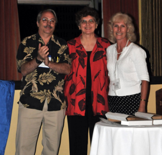 Vicki Funk (center) receives the IAPT Stebbins Medal from Warren Wagner and Pamela S. Soltis (Chair of the Stebbins Medal Committee).  (Photo by Mauricio Bonifacino)