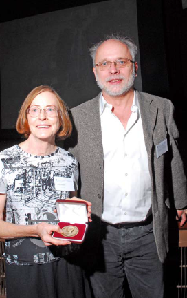 Beryl Simpson, C.L. Lundell Professor of Systematic Botany at the University of Texas at Austin, accepts the 2010 Jose Cuatrecasas Medal for Excellence in Tropical Botany from Laurence Dorr (Chair of the Cuatrecasas Medal selection committee).  (Photo by Ken Wurdack)