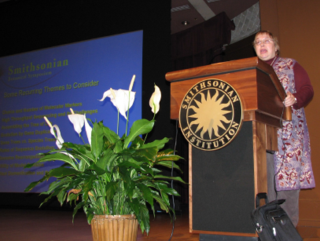 Liz Zimmer, Symposium Convener, welcomes the audience to the eighth annual Smithsonian Botanical Symposium (Photo by Elaine Haug)