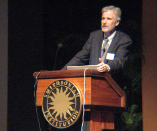 Guest Speaker John Thompson presents a summary and perspective to the Symposium participants. (Photo by Elaine Haug)