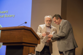 Laurence Dorr presents Paulo Günter Windisch with the 13th José Cuatrecasas Medal in Tropical Botany. (Photo by Ken Wurdack)