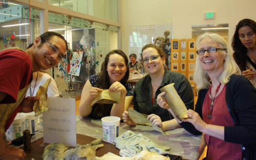 Joel Issak, Meghan Mulkerin, Rebecca Clemens, and Barbara Stauffer at the fish skin sewing activity.