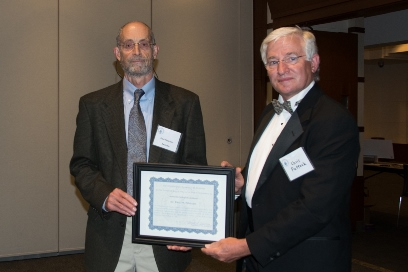 The Award for Outstanding Scientist in Biological Sciences was presented to Paul Peterson by Chris Puttock (right). (photo by Al Teich)