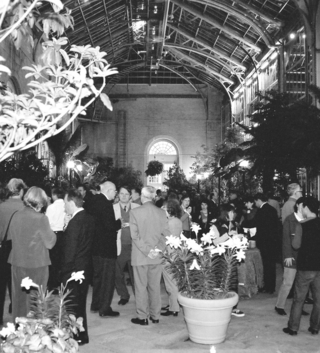 Participants of the Smithsonian Botanical Symposium gathering at the United States Botanic Garden Conservatory for the opening reception. (Photo by Leslie Brothers)