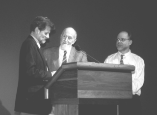 Rogers McVaugh, center, receives the Jose Cuatrecasas Medal for Excellence in Tropical Botany from John Kress, left, and Laurence Dorr at the Smithsonian Botanical Symposium. (Photo by Leslie Brothers)