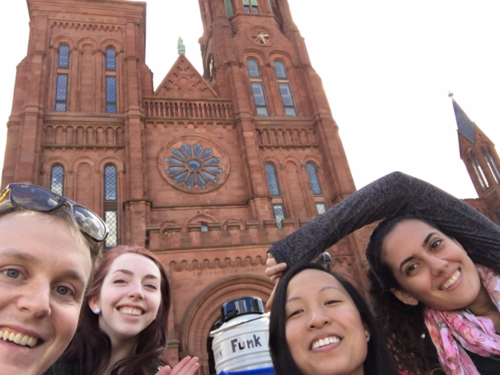 GGI–Gardens team in front of the Smithsonian Castle with blue wagon-toted Funk dewar. From left: Morgan Gostel, and GGI–Gardens interns Kathryn Faulconer, Samantha Vo, and Maryam Sedaghatpour. (photo by Morgan Gostel)