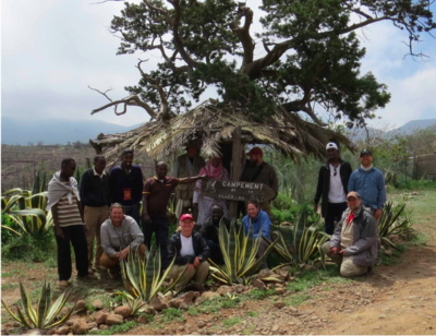 2016 Field camp crew at the Forêt du Day (Day Forest), Djibouti, including students from the local university and staff from the Center for Education and Research Department. Left to Right: Ali Dabelah, Ali Merito, Abdourahman Ismael, Mohammad Ahmed, Steve Gotte, Adwa Ali, Jim Whatton, Yahya Moumine, Brian Schmidt. (Seated): Adam Ferguson, Carla Dove, Kamil Mohamad, Molly McDonough, Jeremy Jacobs. (Photo: Camptment of Forêt du Day).