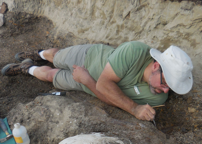 Careful excavation sometimes requires squeezing into tight spaces.
