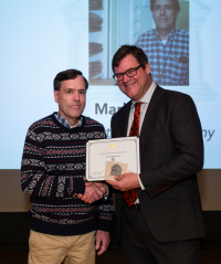 """Mark Strong receiving the """"The Master of Organization Award"""" from NMNH Sant Director Kirk Johnson. (photo by the Smithsonian Institution)"""