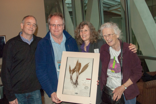 Dan Nicolson was remembered fondly at a memorial service at the National Museum of Natural History on 18 November 2016. His wife, Alice (left), and his three children, John, David, and Sally, display a specimen of Aridarum nicolsonii, an aroid species named in his honor. (photo by Ken Wurdack)