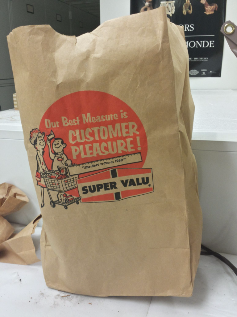 Paper bag with grocery store advertising