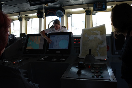 A member of the Okeanos crew explains aspects of navigation at sea to the NMNH volunteers.